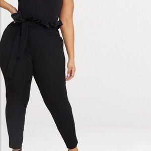Black paper bag skinny pants